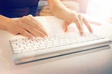 Female hands typing on a white computer keyboard Stock Photo - 15286018