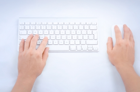 Female hands using mouse and keyboard  photo
