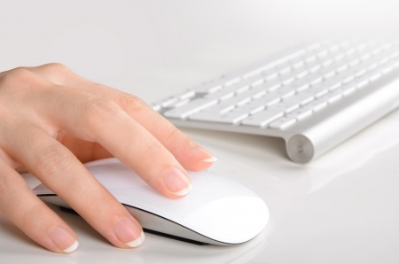 Woman s hand using mouse and keyboard Stock Photo - 16579743