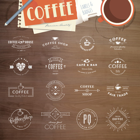 coffee: Set of vintage style elements for labels and badges for coffee, with wood texture, cup of coffee and a notepad in the background