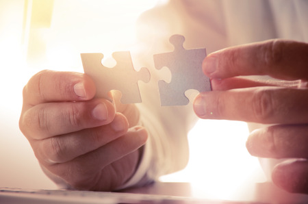 jigsaw pieces: Building a business success. Concept for consulting, marketing, business, strategy and planning.