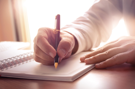 hand pen: Businessman writing on a notebook. Image can be used for several purposes like: background, website banner, promotional materials, poster, presentation templates, advertising and printed materials.