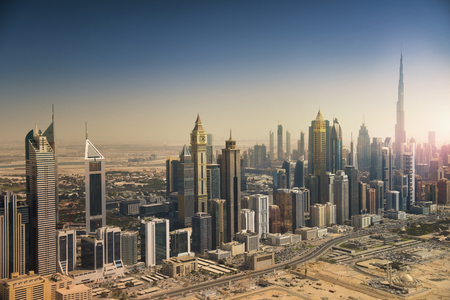 Dubai skyline from the air. Dubai downtown and modern skyscrapers.