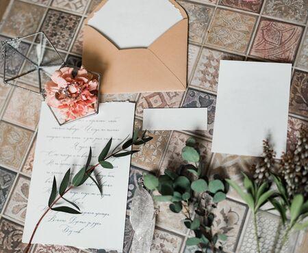 Rustic Wedding invitation card, wax seal, vase, sea stone, flowers. Wedding calligraphy vintage top view