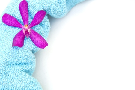 Fresh bath towels with a orchid flower Stock Photo