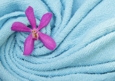 Orchids on the towel spa cosmetic abstract background