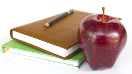 Stack of books with an apple on top Stock Photo - 19244356