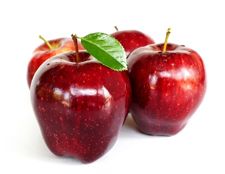 Red Apples with green leaf on white