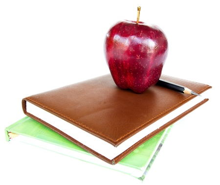 Stack of Books with an Apple and Pencil