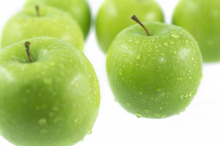 green apples dropping out of focus
