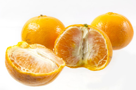 Orange and slice isolated on a white background