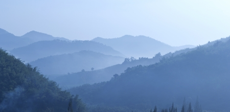 View of far away blue mountains in the fog