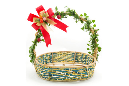 basket decorated with flowers on a white background photo