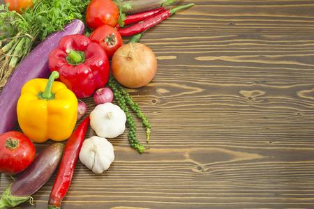 Fresh vegetables mix on wood plank