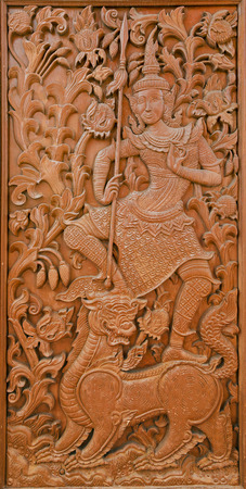 Ancient golden teak carving in Thai classic art style