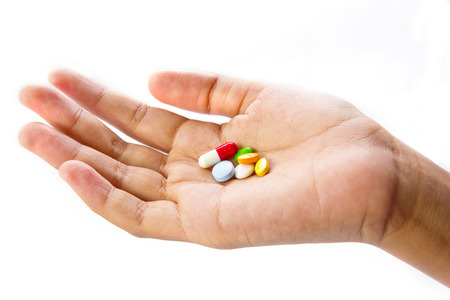 many pills in hand