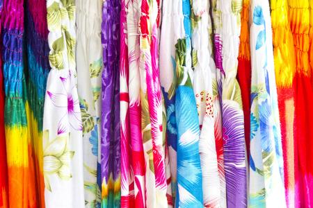 Colourful tropical shirts on beach