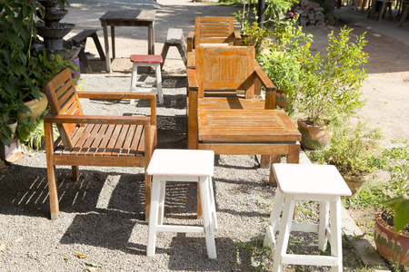 arranging chairs: wooden chairs in an outdoor restaurant