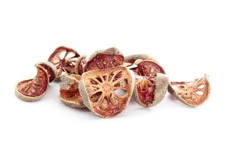 dried bael fruit tea on white background Stock Photo
