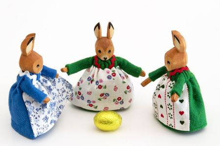 nosh: Three wooden easter bunnies with the golden egg