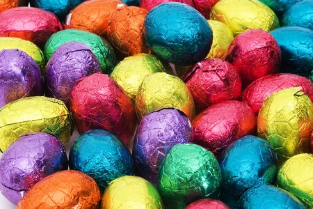 festivities: Easter nest with colorful chocolate eggs Stock Photo