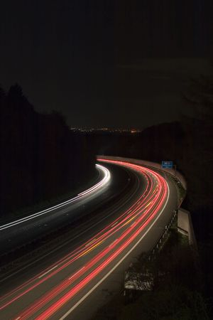 backlights: West German Autobahn at night with headlights and backlights blurred to long white and red lines Stock Photo