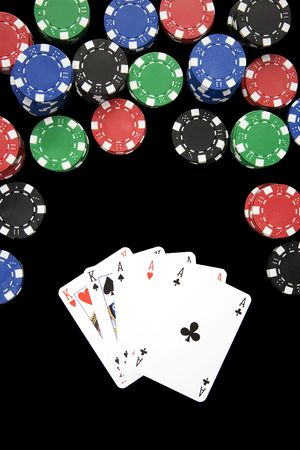 Poker hand of full house with three asses winning a lot of money. Stock Photo - 2807657