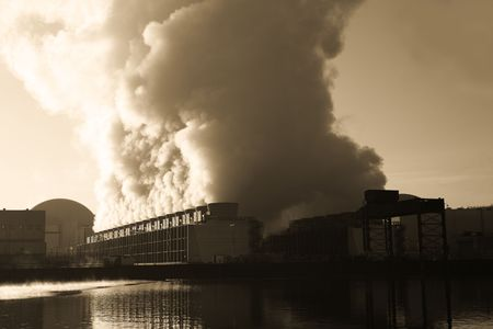 Steaming cooling towers of a nuclear power station in winter. Sepia toned version. Stock Photo - 2902162