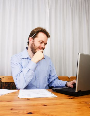 Middle aged man working with laptop and notes at home. Stock Photo - 2946254