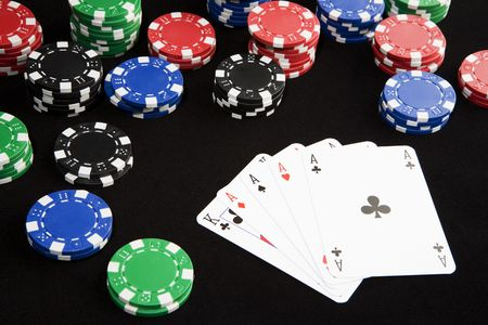 Poker hand with four asses winning a lot of money. Stock Photo - 3615946