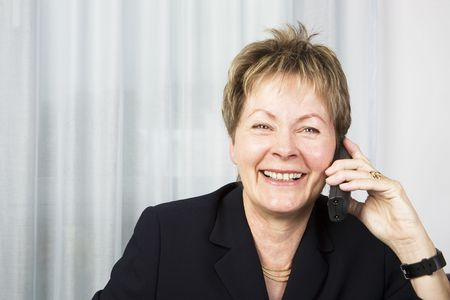 Senior business woman talking on the phone and smiling Stock Photo - 3653753
