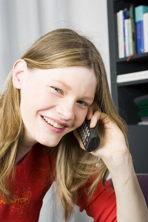 Young teenage girl talking on the phone. photo