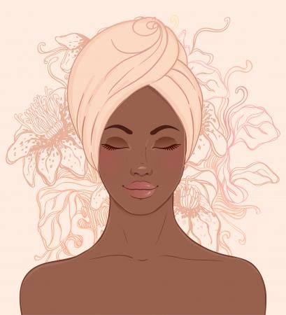 Retrato de la hermosa mujer africana en el turbante con el pendiente