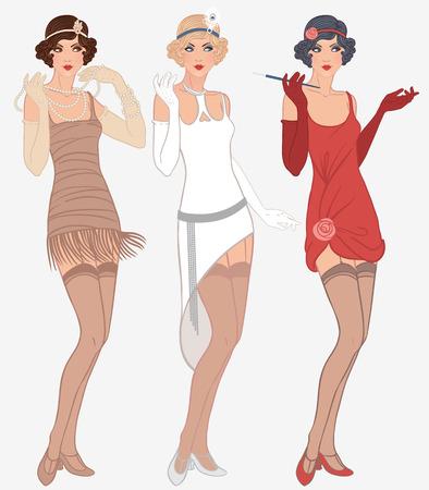 Muchachas de la aleta establecen: tres hermosas mujeres jóvenes de la década de 1920 en diferentes vestidos
