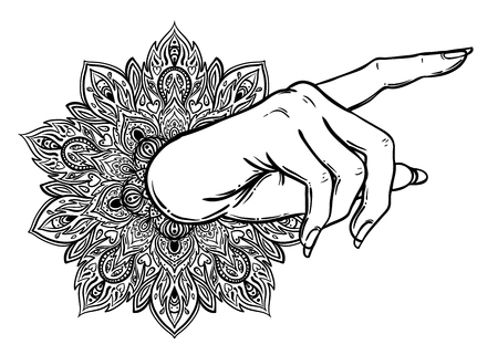 Female hand pointing on something with forefinger.