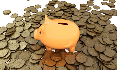 economizing: piggy bank with coins on a white background