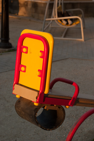 cushioned: Child seats seesow red and yellow with a round rubber guard