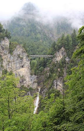 objec: Iron Marienbridge near by castle Neuschwangstein in Schwangau. Stock Photo