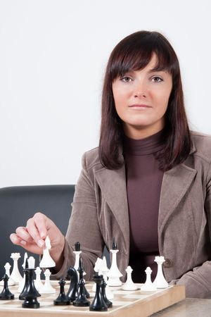 businesswoman playing chess in office photo