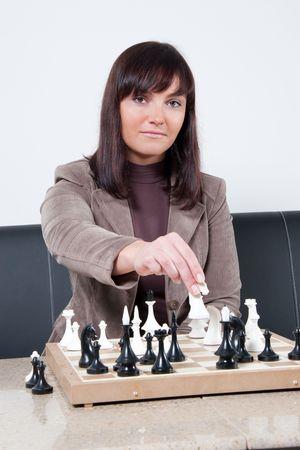 businesswoman playing chess in office Stock Photo