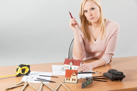 young blond woman, architect at her work table photo