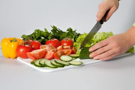 slicing variuos vegetables for salad photo