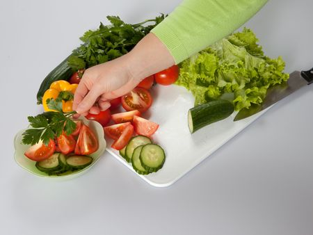 woman decorating salad with parcley photo