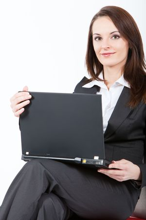 business woman sitting and working with laptop on her knees Stock Photo - 6489998