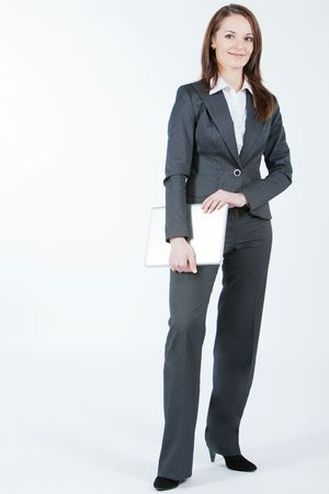 business woman standing and holding computer in hands