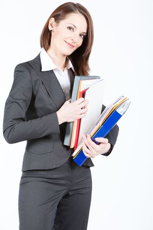 business woman holding folders with documents and searching for file Stock Photo