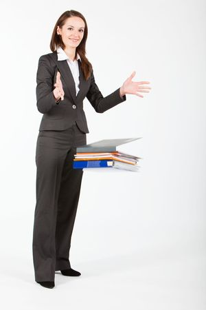 business woman dropping folders with documents photo