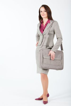 business woman holding a computer case on her shoulder photo