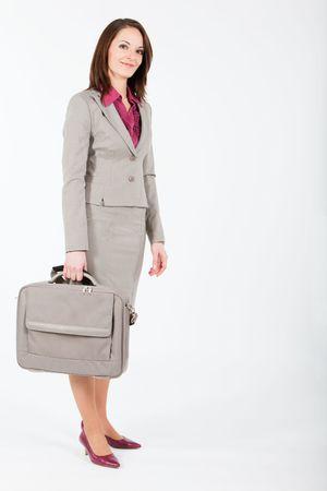 mano derecha: mujer de negocios, sosteniendo un caso de equipo en la mano derecha