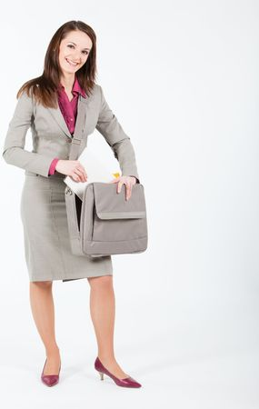 business woman taking out documents from case photo